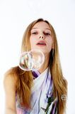 Attractive girl with soap bubbles Stock Images