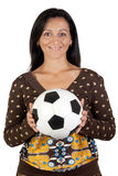 Attractive girl with a soccer ball Royalty Free Stock Photo
