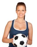 Attractive girl with soccer ball Royalty Free Stock Photo