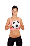 Attractive girl with soccer ball Royalty Free Stock Photography