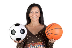 Attractive girl with soccer and basket ball Royalty Free Stock Images