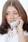 The attractive girl speaking by phone Stock Photo
