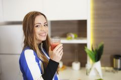 Attractive Girl in Sportswear Drinking Tasty Smoothie royalty free stock images
