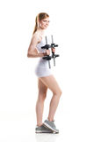 Attractive girl in sportswear having training on bicep with dumbbells on isolated background Royalty Free Stock Image