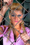 Attractive girl in steel cage Stock Photography
