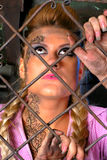 Attractive girl in steel cage Royalty Free Stock Image