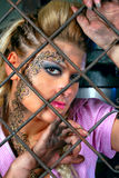 Attractive girl in steel cage Royalty Free Stock Photo