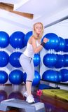 Attractive girl stepping in a fitness center Royalty Free Stock Photography