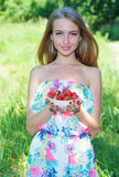 Attractive girl with strawberries Royalty Free Stock Images