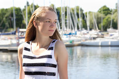 Attractive girl in striped dress on the seashore Royalty Free Stock Photography