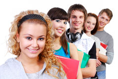 Attractive girl student. Row of smiling classmates with attractive girl student on foreground Royalty Free Stock Photos