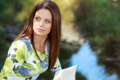 Attractive girl student reading book Royalty Free Stock Photography