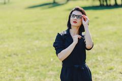 attractive girl in suit on green grass background royalty free stock images