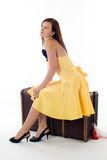Attractive girl on suitcase Royalty Free Stock Images