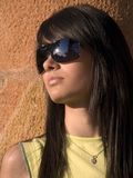 Attractive girl with sunglasses. Beautiful young woman looking towards the sun Stock Images
