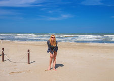 Attractive girl in sunglasses on the beach. Spring Stock Images