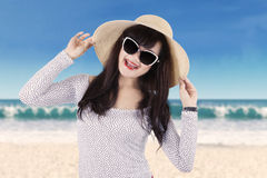 Attractive girl with sunglasses at seaside Stock Images