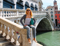 Attractive girl in a sunny day on a bridge in Venice Stock Photos