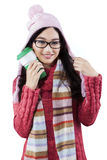 Attractive girl in sweater holds hot drink Stock Image