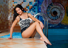 Attractive girl in swimming pool Royalty Free Stock Photography