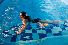 Attractive girl in swimming pool Stock Photos