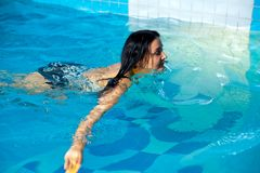 Attractive girl in swimming pool Royalty Free Stock Photos