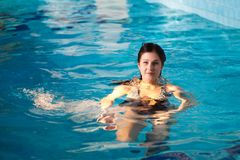 Attractive girl in swimming pool Royalty Free Stock Photo