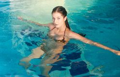 Attractive girl in swimming pool Stock Photo