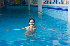 Attractive girl in swimming pool Royalty Free Stock Image
