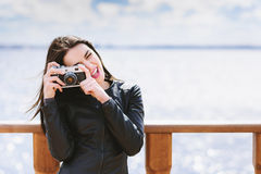 Attractive girl takes pictures with an old camera Stock Image