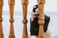 Attractive girl takes pictures with an old camera Royalty Free Stock Images