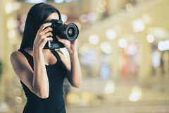 Attractive girl taking photo stock images