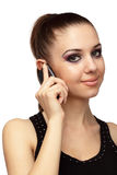Attractive girl talking on a mobile phone. Close up of attractive young woman talking on a mobile phone over white Royalty Free Stock Images