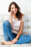 Attractive girl talking on the phone over white background Royalty Free Stock Photos