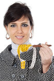 Attractive girl with  tape measure in the hand Stock Photography