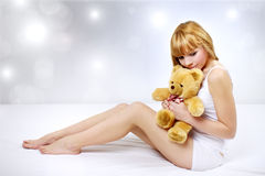 Attractive girl with a teddy bear Royalty Free Stock Photo