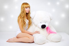 Attractive girl with a teddy bear Royalty Free Stock Photos