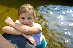 Attractive girl of the teenager near water Royalty Free Stock Photos