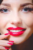 Attractive girl, tempting beuatiful young woman. Closeup portrait of attractive girl, tempting beuatiful young lady with blue eyes, long lashes, red lipstick and stock photo