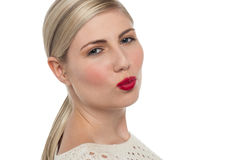 Attractive girl about to kiss you. Attractive blonde with shiny red lipstick about to kiss you Stock Photos