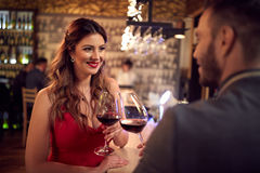 Attractive girl toast with man in night club Stock Images