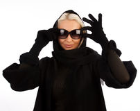 Attractive girl touching her sunglasses Stock Photography