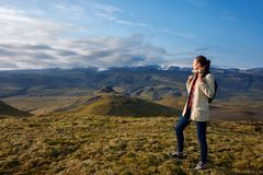 Attractive girl tourist on background of mountain landscape. Iceland Stock Images