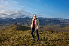 Attractive girl tourist on background of mountain landscape. Iceland Royalty Free Stock Image