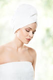 Attractive girl in towel isolated on white. Spa, wellness and he Stock Photo