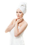 Attractive girl in a towel isolated on white Royalty Free Stock Photography
