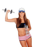 Attractive girl training with dumbbells and drinking water Stock Photo