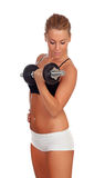 Attractive girl training with dumbbells Royalty Free Stock Photography
