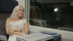 Attractive girl traveling by train stock video