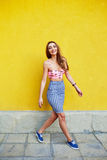 Attractive girl in an unusual skirt Stock Image